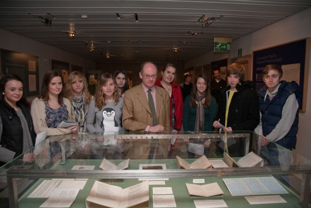 Visitors from The Bishop's Stortford High School with the exhibition curator